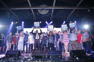 Belk's 2016 Southern Musician Showcase winners celebrate with blue record awards at the competition's finale event.