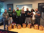 Wounded Warrior Project(R) Alumni with the Thanksgiving baskets, courtesy of the students at Grace Lutheran School.