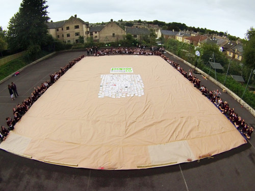 PaperBagCo staff with Fitzmaurice Primary School pupils celebrate breaking the record for the world's largest paper bag. They then all got in the paper bag to attempt to break the world record for the most number of people in a paper bag. (PRNewsFoto/VARN Media) (PRNewsFoto/VARN Media)