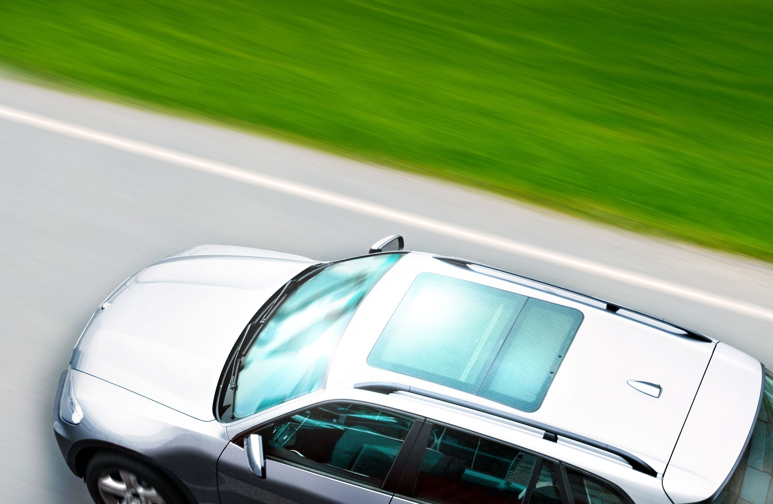 With HeliaFilm, glass sunroofs can now act as photovoltaic harvesters to top up car batteries and allow the car manufacturers to claim Eco-innovation credits towards CO2 emission goals. (PRNewsFoto/Heliatek GmbH)