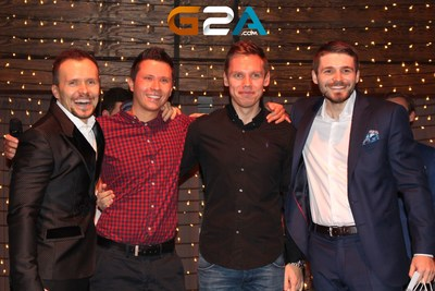 G2A CEO Bartosz Skwarczek, with special guests: Tomasz Szpadrowski from Google, and Rafal Kaniecki from Facebook and G2A CMO Dawid Rozek, celebrating the G2A Winter Wonderland Party and G2A's Birthday. (PRNewsFoto/G2A.com)