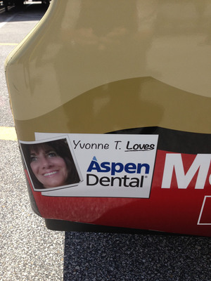 Yvonne T., a patient of the Orange, CT Aspen Dental practice, will have her winning smile featured on the tail of Ryan Newman's No. 39 Outback Steakhouse Chevrolet during the NASCAR Sprint Cup Coke Zero 400 Powered by Coke at Daytona International Speedway on Saturday, July 6.  (PRNewsFoto/Aspen Dental)