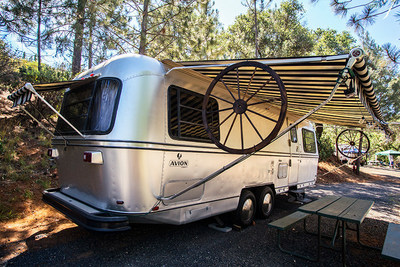 The 31' Silver Avion luxury trailer comfortably sleeps four people on a full-size sofa bed that sleeps two, and two twin beds in bedroom. Inside, you will find a fully-furnished and restored interior with range, microwave and refrigerator in kitchen area, and a bathroom. Deck offers outdoor furniture and a gas grill. Includes linens and a flat screen TV with Blue-ray player. Stay in this trailer and easily imagine a day when life was simpler and these popular trailers were seen across the land taking families to new adventures.