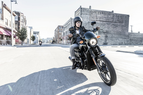 A rider takes to the street on the new Harley-Davidson Street(tm) 750, one of two new Dark Custom(tm) ...