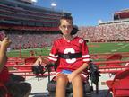 Branden at the Nebraska Cornhuskers game.  (PRNewsFoto/Kids Wish Network)