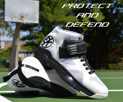 "Etkio's ""The Breakaway"" basketball shoes in white and black.  (PRNewsFoto/Ektio Athletic Shoes)"