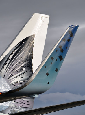 The new Salmon-Thirty-Salmon II plane boasts fish scales on the winglets. Four gallons of Mylar paint was used to create an iridescent sparkle over the nearly 3,500 fish scales decorating the plane.  (PRNewsFoto/Alaska Airlines)