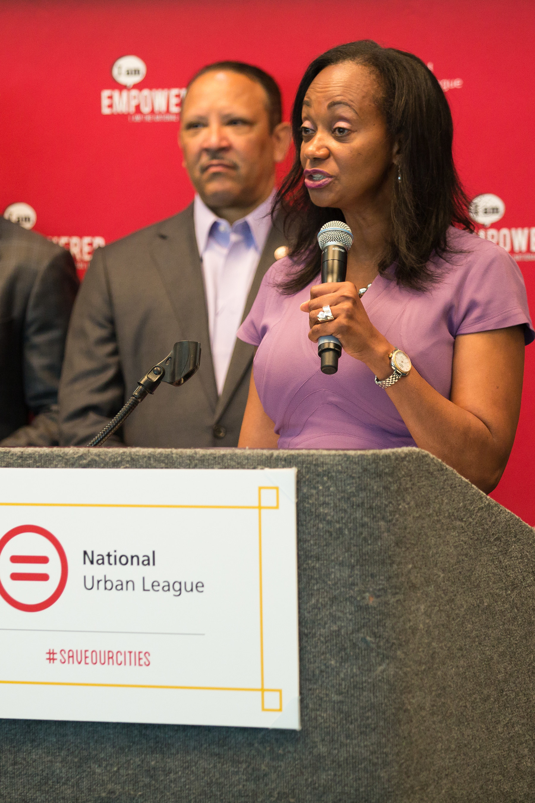 Marc Morial, President & CEO, National Urban League, looks on as Alva Mason, National Manager, African American Business Strategy Group, Toyota North America, speaks at the opening press conference today at the 2015 National Urban League conference in Ft. Lauderdale.