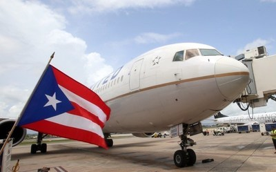 Puerto Rico flag in front of United airplane