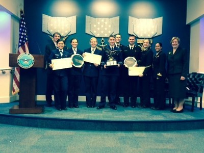 From left to right:  Robert Budway, Cadet Eva Saudris, Cadet Ivonne Lassalle, Cadet Carlie Gilligan, Cadet Victor Broskey, Midshipman Peter Rockhold, Midshipman Adam Hammer, Midshipman Alex McIntosh, LTJG Maria Beltre, and Ms. Maureen Sullivan