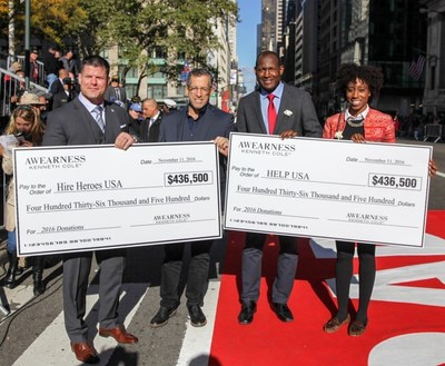 Kenneth Cole, Chairman and Chief Creative Officer of Kenneth Cole Productions, awarded Brian Stann, President and CEO of Hire Heroes USA and Marine combat veteran, and HELP USA's Jahmila Vincent, Program Director at HELP Hollis Garden Apartments, and Linson Baily Alexander, Executive Director of HELP USA's National Supportive Services for Veteran Families, with their donation checks.