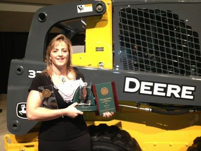 Marcia Bornemann, Inside Sales Representative for the John Deere account shows proudly the fruits of her labor - Partner Supplier Award, 5-Year Hall of Fame Award and Supplier of the Year Award. (PRNewsFoto/SSAB AB)