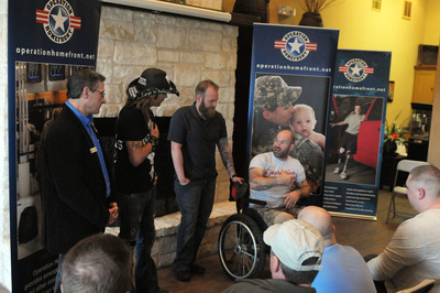 Singer Bret Michaels (center left) met with wounded warriors at Operation Homefront Village in San Antonio this week. The legendary musician, entrepreneur, and philanthropist visited the transitional housing facility to thank, support and provide a voice for our wounded warriors. (Also pictured, left, Operation Homefront Vice President Dino Sarracino; center right, wounded warrior Kenny Walker; right, wounded warrior Stephen Jackel.) With Village communities in the San Antonio, Oceanside, Calif. and Washington, D.C. areas, transitional housing through Operation Homefront Villages constitutes a vital program for wounded warriors and their families as they undergo rehabilitation and transition from military to civilian life. (PRNewsFoto/Operation Homefront) (PRNewsFoto/OPERATION HOMEFRONT)