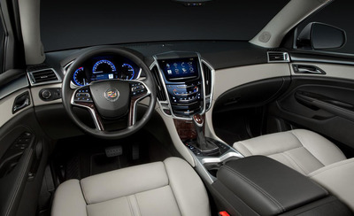 The interior of Cadillac's new SRX delivers entertainment and comfort for front and rear seat passengers.  (PRNewsFoto/Bill Jacobs Automotive Group)