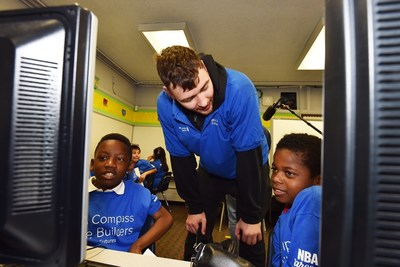 Houston Rockets' Donatas Motiejunas works with students at The Rusk School as part of BBVA Compass' Future Builders Program.