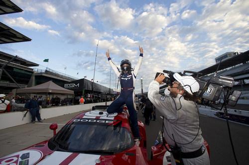 Driver Jonathan Bomarito celebrates winning first place in the GTLM class in the IMSA TUDOR United SportsCar ...