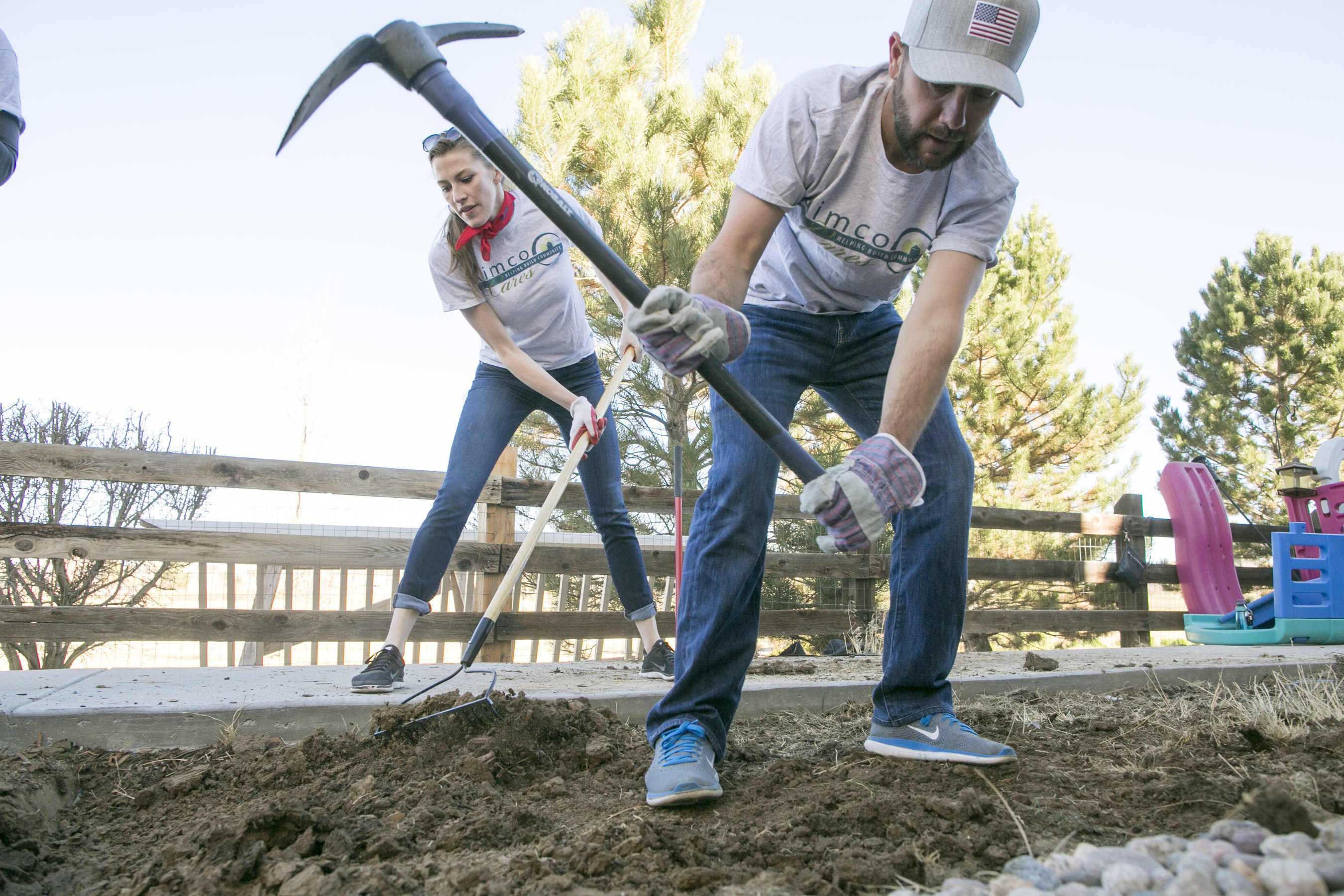 Aimco team members helped landscape the yard at the home of a disabled U.S. Navy veteran to give him access to the play area enjoyed by his daughter.