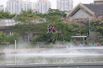 A KuangChi Martin Jetpack flies over a lake during a demonstration in Shenzhen, China on December 6, 2015.