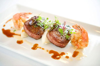 Filet Medallions and Scampi Style Gulf Shrimp, Garlic Mashed Potato and Bordelaise is one of the dishes offered on Sullivan's new $39 Every Day Pre-Fixe Three-Course Menu.  (PRNewsFoto/Sullivan's Steakhouse)