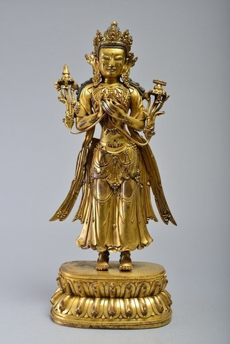 Gilt-bronze figure of Avalokitesvara on lotus base, Ming Dynasty, 23 1/2 inches tall, purchased by a LiveAuctioneers bidder for $197,430 on May 18, 2014 at Wichita Auctioneers, New York City. Image courtesy of LiveAuctioneers Archive and Wichita Auctioneers (PRNewsFoto/LiveAuctioneers)