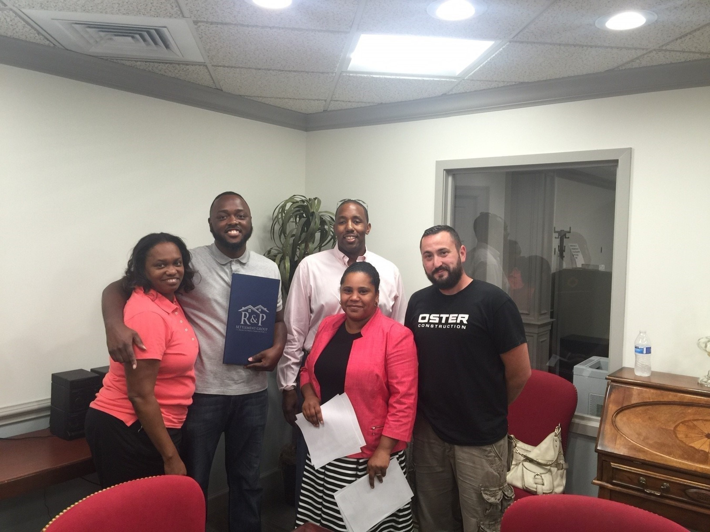 From Left to Right (First time home buyer Jerel Brown) Jacinta Brown, Jerel Brown Baltimore City Housing Department, Kevin Seawright RPS Solutions LLC, Desiree Eades-Jones Long & Foster Realty, Igor Oster RPS Solutions LLC