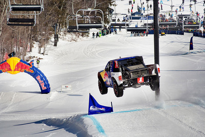 Pro-4 off-road racing truck took to the snowy incline of Mount Snow to prove what's possible for Red Bull Frozen Rush. Just one week after record-breaking snowfall in the Northeast, Champion off-road racer Ricky Johnson took advantage of all the extra powder by riding a figure eight trail with jumps and berms while thousands of winter and motorsports fanatics cheered him on. Ricky faced an onslaught of new challenges when entering the frozen playground and while plowing upward, hitting jumps, he destroyed the perception that off-road racing trucks can't succeed on snow.  (PRNewsFoto/Red Bull)