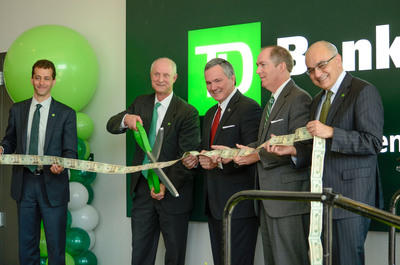 TD Bank executives and local officials mark the opening of TD's Greenville Corporate Campus with a ribbon cutting. Pictured, from left, Robert Ghazal, Head of U.S. Phone Channel, TD Bank; Rob Hoak, Regional President for South Carolina, TD Bank; Bobby Harrell, S.C. Speaker of the House; Knox White, Mayor of Greenville; Bharat Masrani, President and CEO, TD Bank. (PRNewsFoto/TD Bank) (PRNewsFoto/TD BANK)