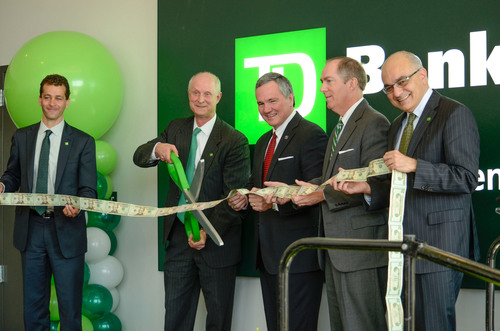 TD Bank executives and local officials mark the opening of TD's Greenville Corporate Campus with a ribbon cutting. Pictured, from left, Robert Ghazal, Head of U.S. Phone Channel, TD Bank; Rob Hoak, Regional President for South Carolina, TD Bank; Bobby Harrell, S.C. Speaker of the House; Knox White, Mayor of Greenville; Bharat Masrani, President and CEO, TD Bank.  (PRNewsFoto/TD Bank)