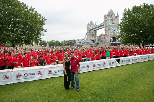 Papa John's Founder, John Schnatter, and Natalie Lowe, star of Strictly Come Dancing, pose for a photo after breaking a GUINNESS WORLD RECORD with 338 people tossing pizza at once. (PRNewsFoto/Papa John's) (PRNewsFoto/Papa John's)