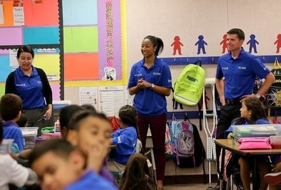 WNBA's Briann January (center) and BBVA Compass Phoenix CEO Brad Parker (right) share the importance of financial education with William T. Machan students during the BBVA Compass Future Builders Program in Phoenix on Nov. 12.