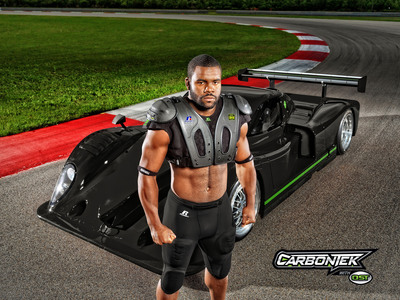 Russel Athletic ambassador Mark Ingram models the brand's first ever football shoulder pad system, CarbonTek with OS Technology at NOLA Motorsports Park in New Orleans, La. (Photo Courtesy of Russell Athletic). (PRNewsFoto/Russell Brands, LLC) (PRNewsFoto/RUSSELL BRANDS, LLC)