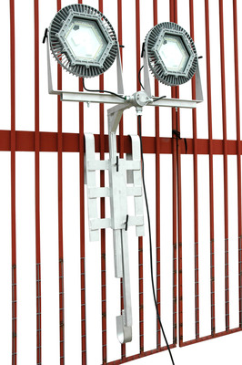 The EPL-JH16C-2X1MLED-100 saves space for operators working with scaffolding, railing or ladders during cleaning and maintenance in hazardous areas. With the ability to position each LED head independently, and delivering a combined 20,000 lumens, operators aren't tying up floor space or creating trip hazards when using this explosion proof LED lighting system.  (PRNewsFoto/Larson Electronics)