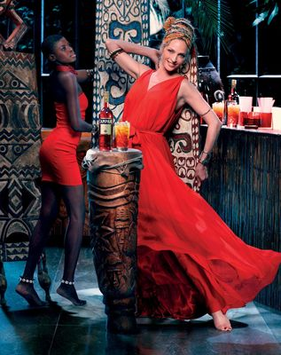 Campari Calendar 2014 – Worldwide Celebration. Star: Uma Thurman Photographer: Koto BolofoOutfit: Maiyet custom made dressJewelry: Sarah Chilton Designs 'The Wide Cuff' featuring amethyst and orange chalcedony stones, and is plated in 18k Yellow GoldOpen Harness Bracelet, hand cast and plated in 18K goldStacked Signature Skinny Bangles, hand cast and plated in 18K goldDrink: Campari Orange Passion