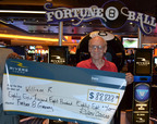 "On June 24, 2012, Rivers Casino, the newest casino in the Chicagoland-area, awarded one lucky guest, William R. of Chicago, Illinois $88,888 cash during the Fortune 8 Ball Giveaway.  When asked how he was feeling after winning the Fortune 8 Ball Giveaway, William replied, ""I'm freaking out! I can't believe it!"" When asked how he was going to spend his winnings, he replied ""I don't know but for now I'm going back to the tables!"" Rivers Casino has given away over $400,000 in Fortune 8 Ball Free Slot Play and prizes since the giveaway began in early June.  (PRNewsFoto/Rivers Casino)"
