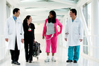 L to R: Dr. Fardad Esmailian, Rotch Delos Santos, RN, Total Artificial Heart patient Michelle Johnson and Dr. Jaime Moriguchi on March 1, 2012.  Photo by Cedars-Sinai Medical Center.  (PRNewsFoto/SynCardia Systems, Inc.)