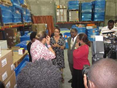 Haiti's First Lady Sophia Martelly and Health Minister Florence Duperval Guillaume tour  Direct Relief's warehouse in Port-au-Prince, Haiti, Wednesday, Sept. 10, 2014, which holds a donation of millions of treatments for the mosquito-borne virus chikungunya. The virus has sickened tens of thousands in the Caribbean and Central America since its arriving in the region last year. (PRNewsFoto/Direct Relief)
