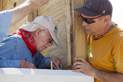 Former U.S. President Jimmy Carter and country music superstar Garth Brooks work together on one of 100 houses being built in the Santo community of Leogane, Haiti, as the 28th annual Jimmy and Rosalynn Carter Work Project. (c)Habitat for Humanity/Steffan Hacker.  (PRNewsFoto/Habitat for Humanity International, Steffan Hacker)