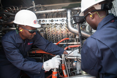 Workers at APR Energy's fast-track power plant in Luanda, Angola