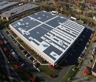 Pfister Energy's Stackable Solutions. White energy efficient roofing system, solar photovoltaic array and prismatic skylights with integrated daylight harvesting LED lighting.
