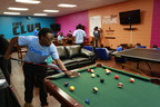 London Watkins, 17, shoots pool on a new table as Aaron's employees and members of the Eastside Boys and Girls Clubs of San Antonio unveil the newly remodeled Keystone Club (Teen Center), in San Antonio, Monday, February 16, 2015. (J. Michael Short/AP Images for Boys & Girls Club of America)