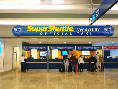 SuperShuttle desk at the Cancun International Airport. SuperShuttle provides shared-ride and ExecuCar (Black Car service) in Cancun and Cabo San Lucas, Mexico.  (PRNewsFoto/SuperShuttle International, Inc.)