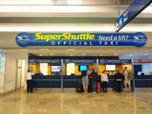 SuperShuttle desk at the Cancun International Airport. SuperShuttle provides shared-ride and ExecuCar (Black ...