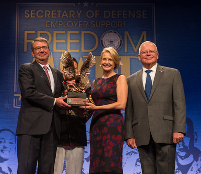 Secretary of Defense Ashton B Carter recognizes CEO Catherine Monson of FASTSIGNS International Inc at the DoD Freedom Awards August 26 2016 in the Pentagon Auditorium US Army photo by Sgt Ricky Bowden