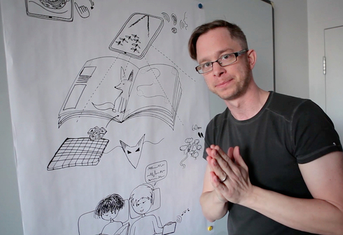 Jonathan Belisle presenting Wuxia's Book & App interactions. (PRNewsFoto/Wuxia the Fox )