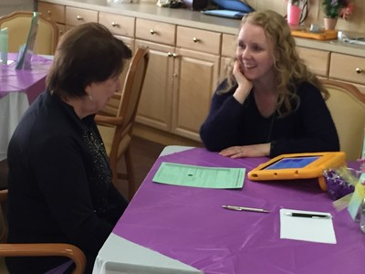 Mary Kelly, APN, Palliative Care Nurse Practitioner at Robert Wood Johnson New Brunswick discusses the POLST form with a Bridgeway family member.