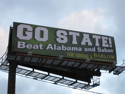 A billboard in Detroit promotes MSU and takes a subtle swipe at Alabama Coach Nick Saban, who left MSU abruptly to take a job elsewhere. MSU faces Alablama on New Year's Day in the Capitol One Bowl.  (PRNewsFoto/Barlow Communications)