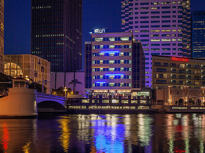 "Pharos CB Hospitality, LLC has acquired Aloft Tampa Downtown, an upscale select-service hotel on the Tampa Riverwalk.  The hotel is in walking distance to the Tampa Convention Center, The Florida Aquarium, the University of Tampa, and the Amalie Arena.  ""This acquisition is an attractive long-term investment for our investors in a one-of-a-kind location,"" says J. Edward ""Buddy"" Watson of Pharos CB Hospitality.  Pharos develops and operates upscale hotels in the United States."