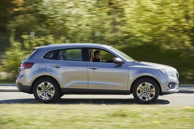 """Christian Borgward on the BORGWARD BX7 AWD: """"The chassis and steering are as direct as is necessary and as comfortable as possible. I didn't expect to see this type of combination in such a large and tall SUV- the car is as fun to drive in the city as it is on country roads and big highways!"""" (PRNewsFoto/BORGWARD Group AG)"""