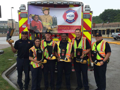 Fire Fighters from Dallas Fire-Rescue collected donations during the Dallas area Fill the Boot drive, MDA's largest to date, to help support kids and adults with muscle-debilitating diseases.