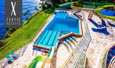 Exotic Estates - Rainbow Falls Villa. Epic Big Island villa with Olympic-size pool and waterslide, golf course, tennis and basketball courts.